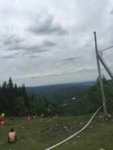 This was the top of the fourth hill, which came immediately after climbing up and down the third hill. No obstacle breaks. 590 m elevation. There were about 40 people sitting/lying down taking a break.